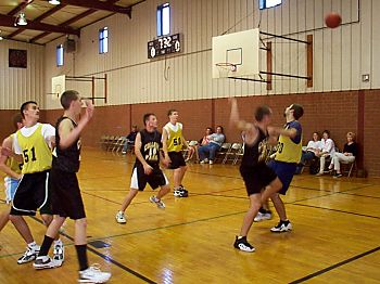 Senior guys play basketball
